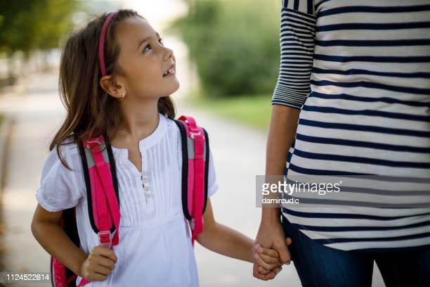 cute cheerful schoolgirl going home - first day of summer stock pictures, royalty-free photos & images