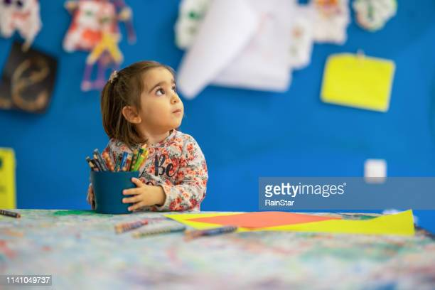 cute child draw with colorful crayons - colouring stock pictures, royalty-free photos & images