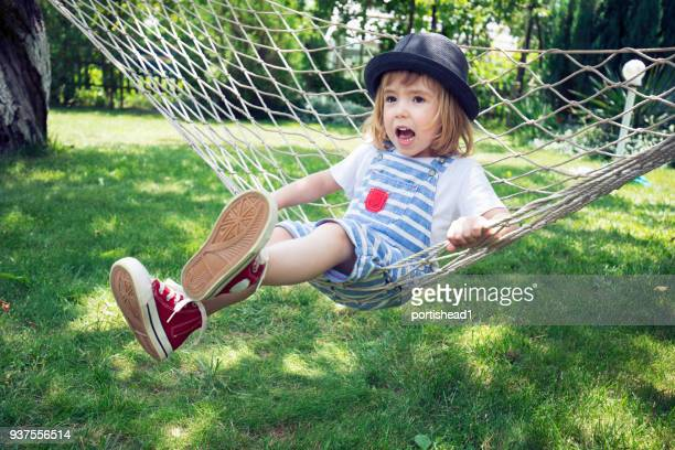 Cute child having fun on hammock