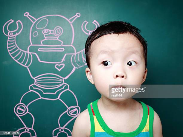 Cute child in front of the blackboard