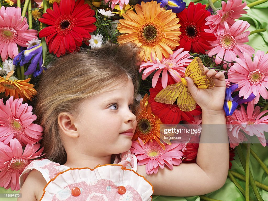 cute child lying on the flower stock photo | getty images