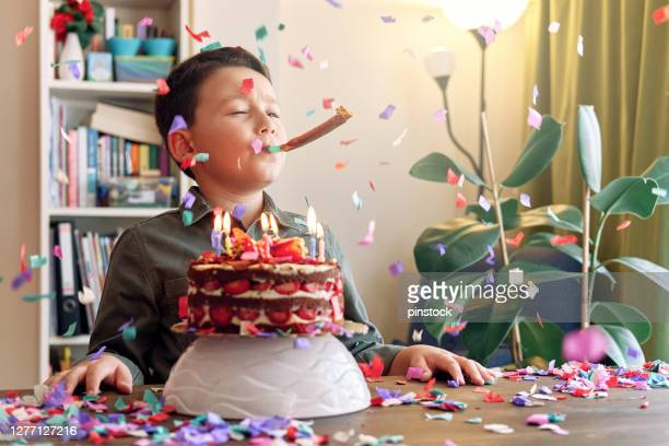 cute child making birthday party with cake and party confetti. birthday party and big celebration at home - birthday candle stock pictures, royalty-free photos & images