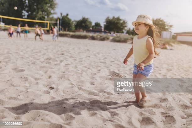 Cute child with a hat having fun on a beach