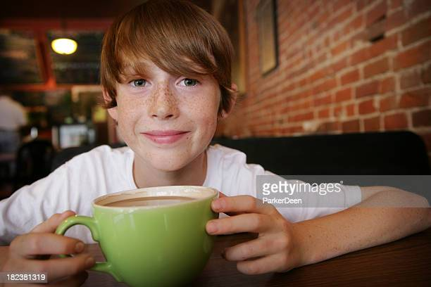 Cute Child with Hot Chocolate or Coffee