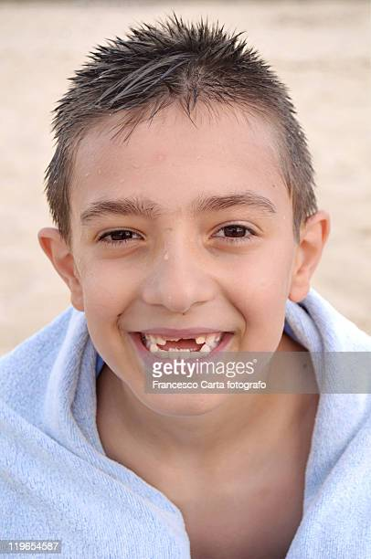 cute child with no frontal teeth - rotting stock pictures, royalty-free photos & images