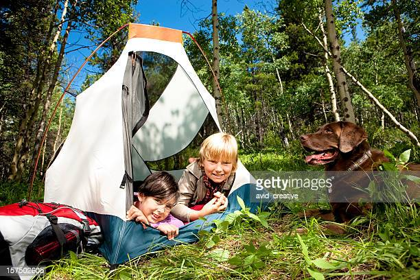 Cute Children Camping with Their Dog