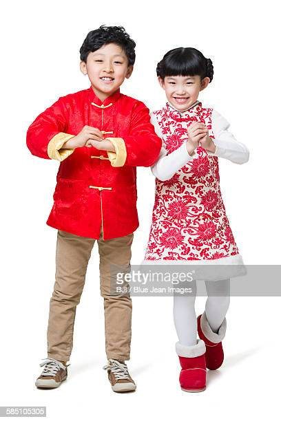 Cute children greeting for Chinese new year