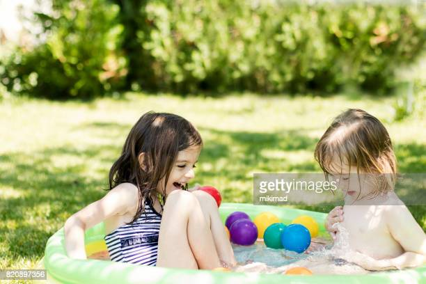 Cute children having fun in swimming pool
