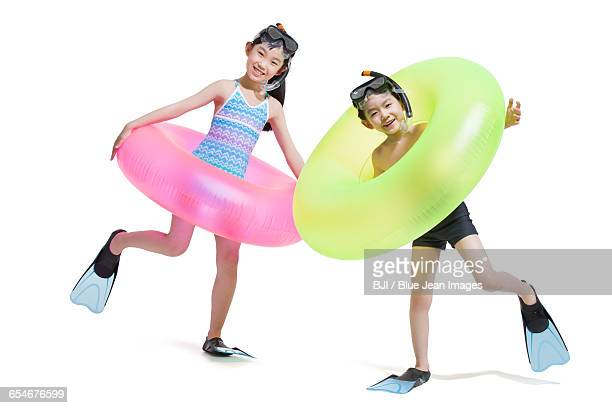 Cute children in swimsuit with swim rings