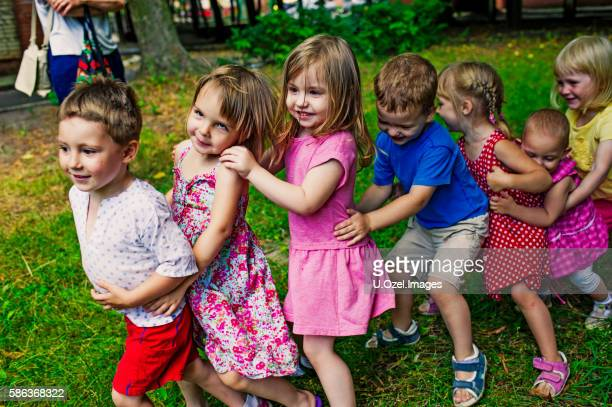 Cute Children Playing At Park