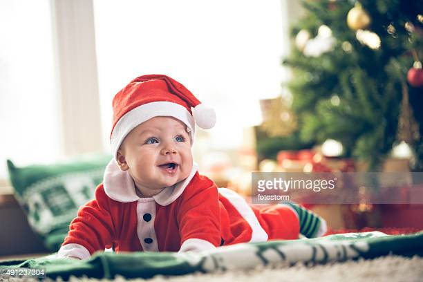 cute christmas baby boy - santa hat stock photos and pictures