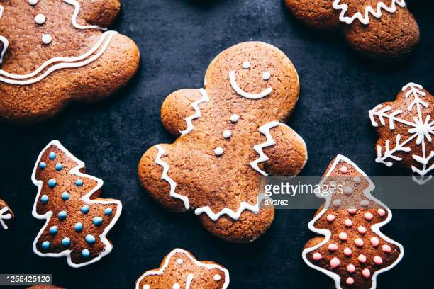 cute christmas gingerbread man - gingerbread men stock pictures, royalty-free photos & images