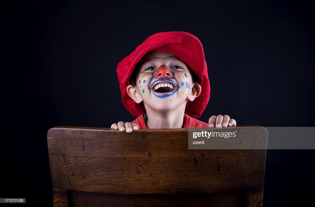 cute clown on chair : Stock Photo