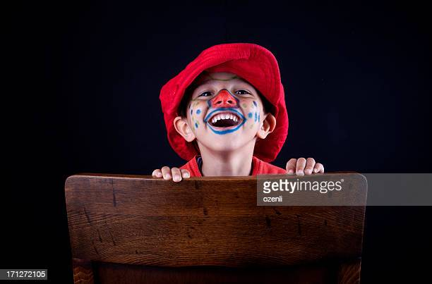 cute clown on chair - happy clown faces stock photos and pictures