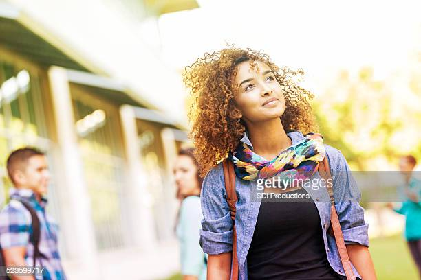 cute college student walking around campus on sunny day - beautiful black teen girl stock photos and pictures