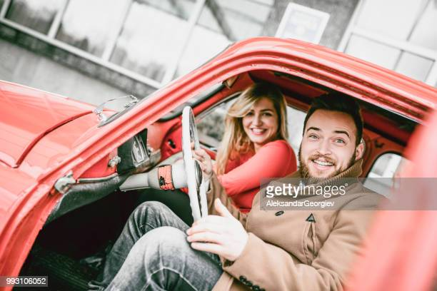 Cute Couple Enjoying Vacation And Traveling In Old Car