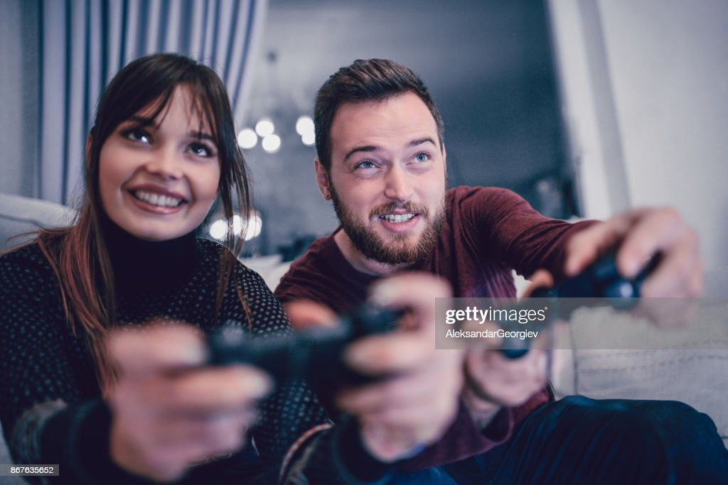 Cute Couple Playing Video Games On Date Night High Res Stock Photo Getty Images