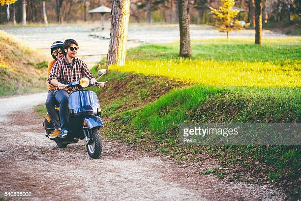 Cute couple riding scooter