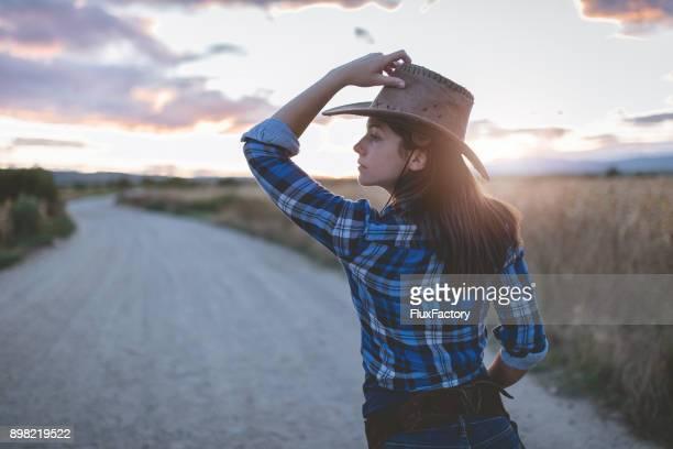 Cute cowgirl in blue plaid shirt