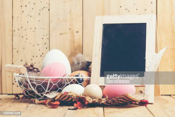 cute creative photo with easter eggs, ester background with colorful easter eggs, vintage filter... - book of ester stock pictures, royalty-free photos & images