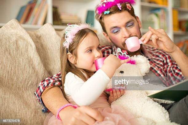 cute daughter and her father having princess time. - tea party stock pictures, royalty-free photos & images