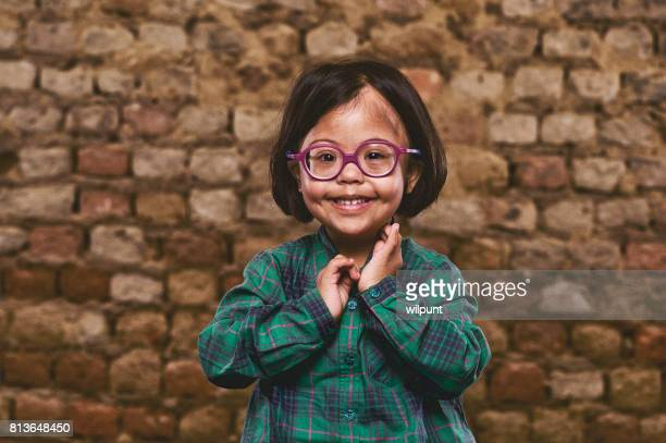 cute down syndrome girl - developmental disability stock photos and pictures