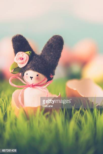 Cute Easter still life with bunny and eggs in grass