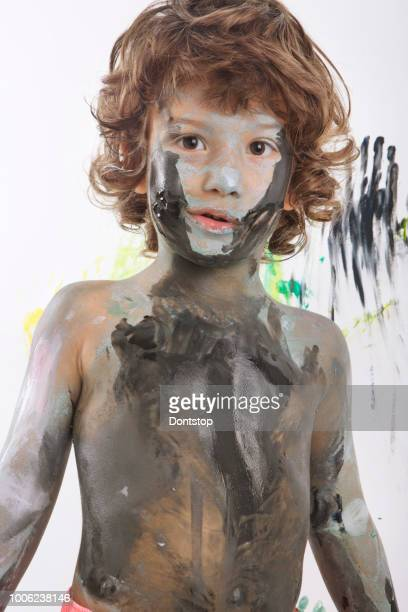 cute excited boy with hands full of finger paint.  photos cute excited boy with hands full of finger paint - 4 girls finger painting stock photos and pictures