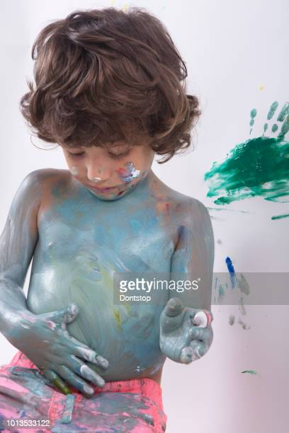 Cute excited boy with hands full of finger paint.  Photos Cute excited boy with hands full of finger paint