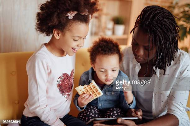 Cute family looking at tablet