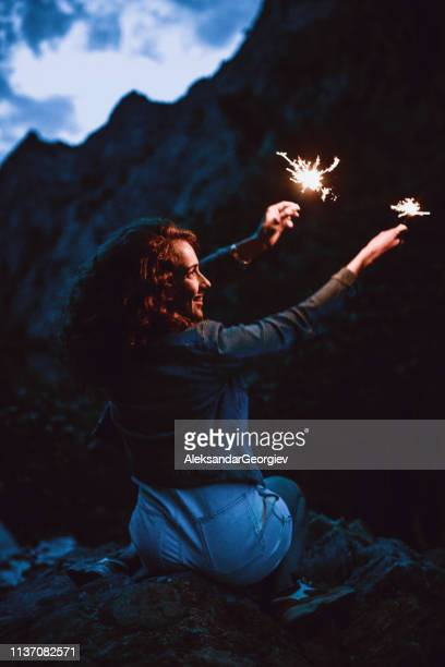 Cute Female Celebrating Annual Camping Trip In Mountains