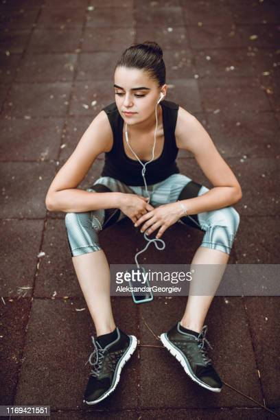 cute female listening to music after workout - colors soundtrack stock pictures, royalty-free photos & images