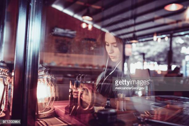 cute female make video conference with smartphone in coffee bar - mp3 juices stock photos and pictures