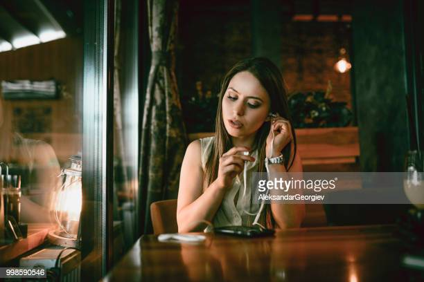 cute female preparing for video conference - mp3 juices stock photos and pictures