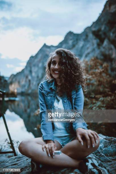 Cute Female Relaxing On Camping Trip In Mountains