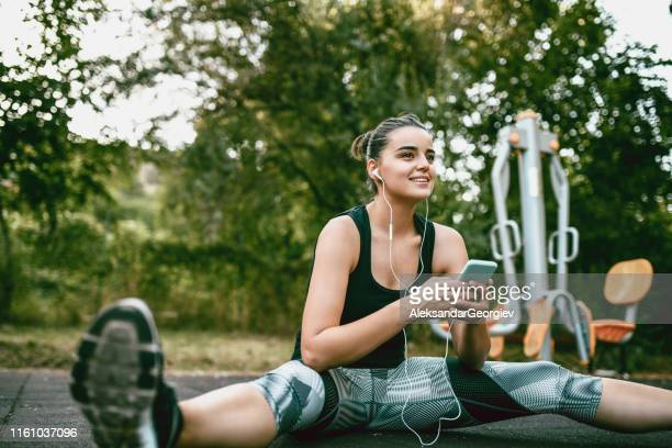 cute female stretching in park - colors soundtrack stock pictures, royalty-free photos & images
