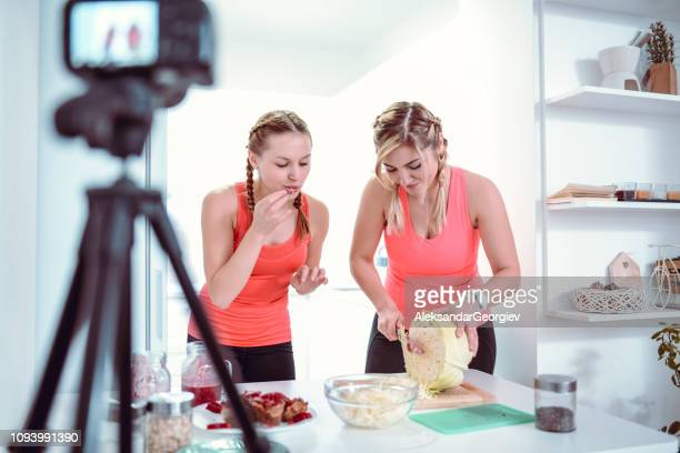 Cute Females Recording a Vlog About Vegan Food