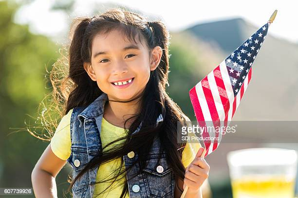 Cute Filipino girls holds American flag