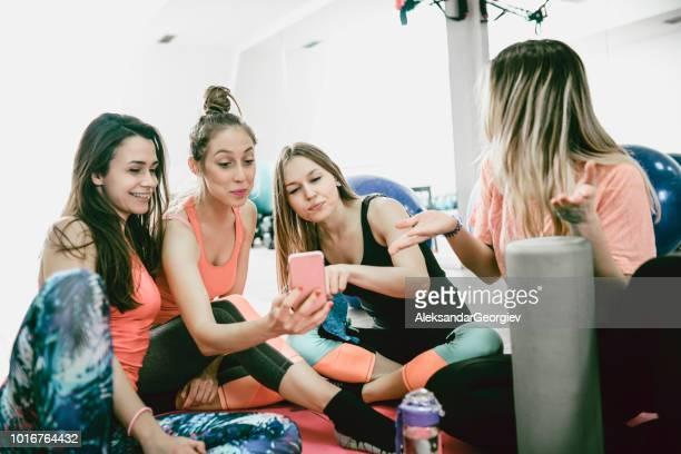 Cute Fit Females Taking A Selfie In Gym