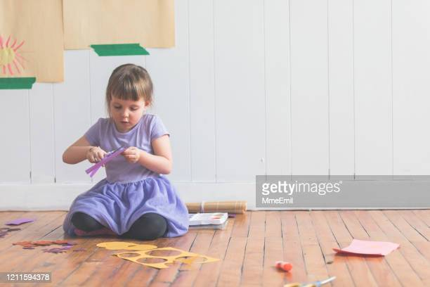 cute four years old girl cutting diy paper craft - mmeemil stock pictures, royalty-free photos & images