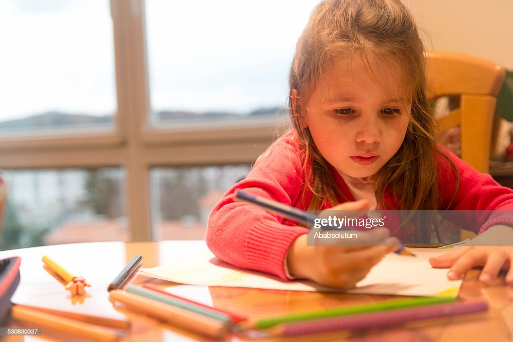 Cute Four Years Old Girl in Pink Drawing at Home : Stock Photo