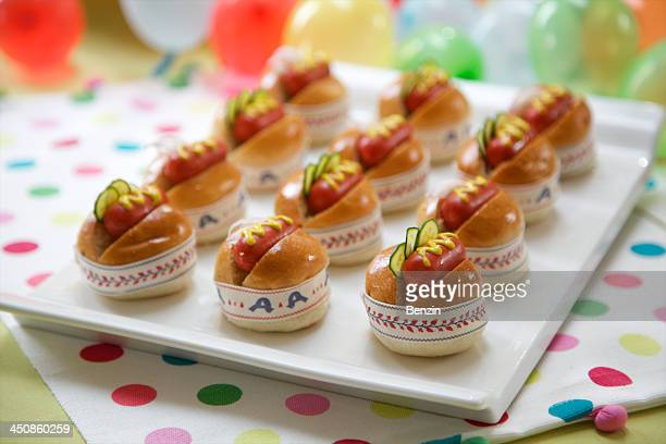 Cute garnished mini sausage burgers with ribbons