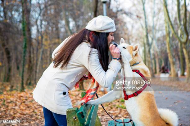 Cute girl and her dog spending day together and having fun
