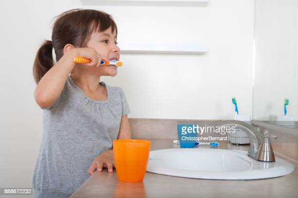 cute girl brushing teeth - human teeth stock pictures, royalty-free photos & images