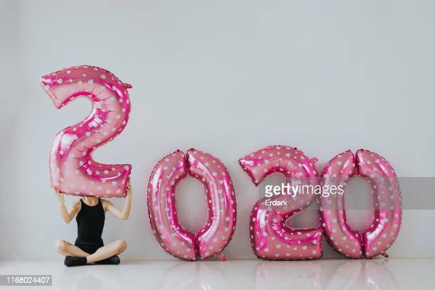 cute girl carry balloon with new year 2020 concept - hogmanay stock pictures, royalty-free photos & images