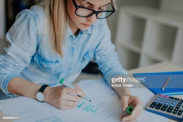 Cute girl doing homework at home
