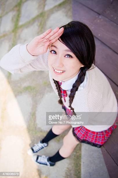 Cute girl doing salute action