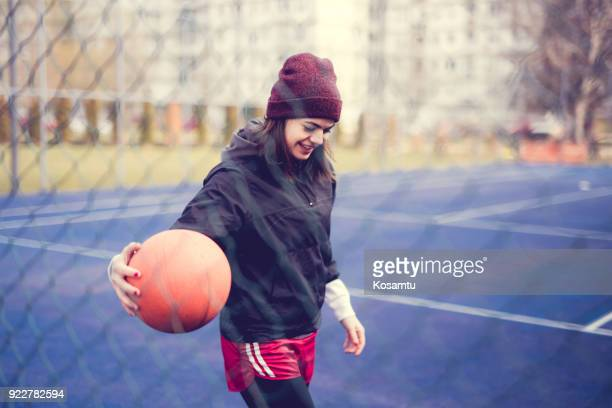 cute girl dribbling basket ball on playing field - dribbling sports stock pictures, royalty-free photos & images