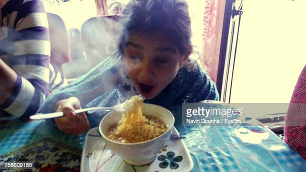 Cute Girl Eating Noodles At Restaurant