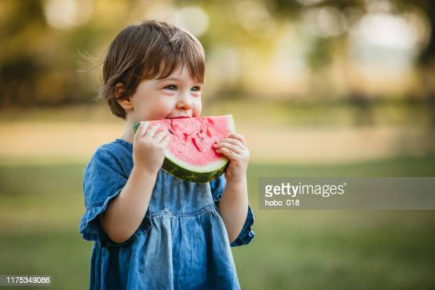 cute girl eating watermelon - watermelon stock pictures, royalty-free photos & images